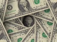 El dólar gana posiciones en vísperas de Navidad